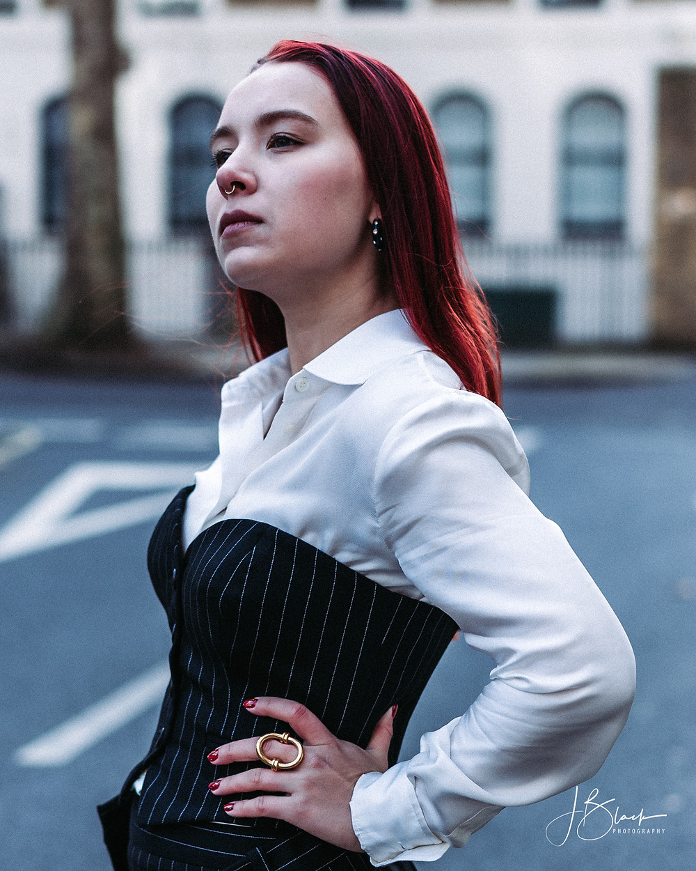 Tatiana dressed in a hite satin shirt and a pinstripe corset by Moschino.