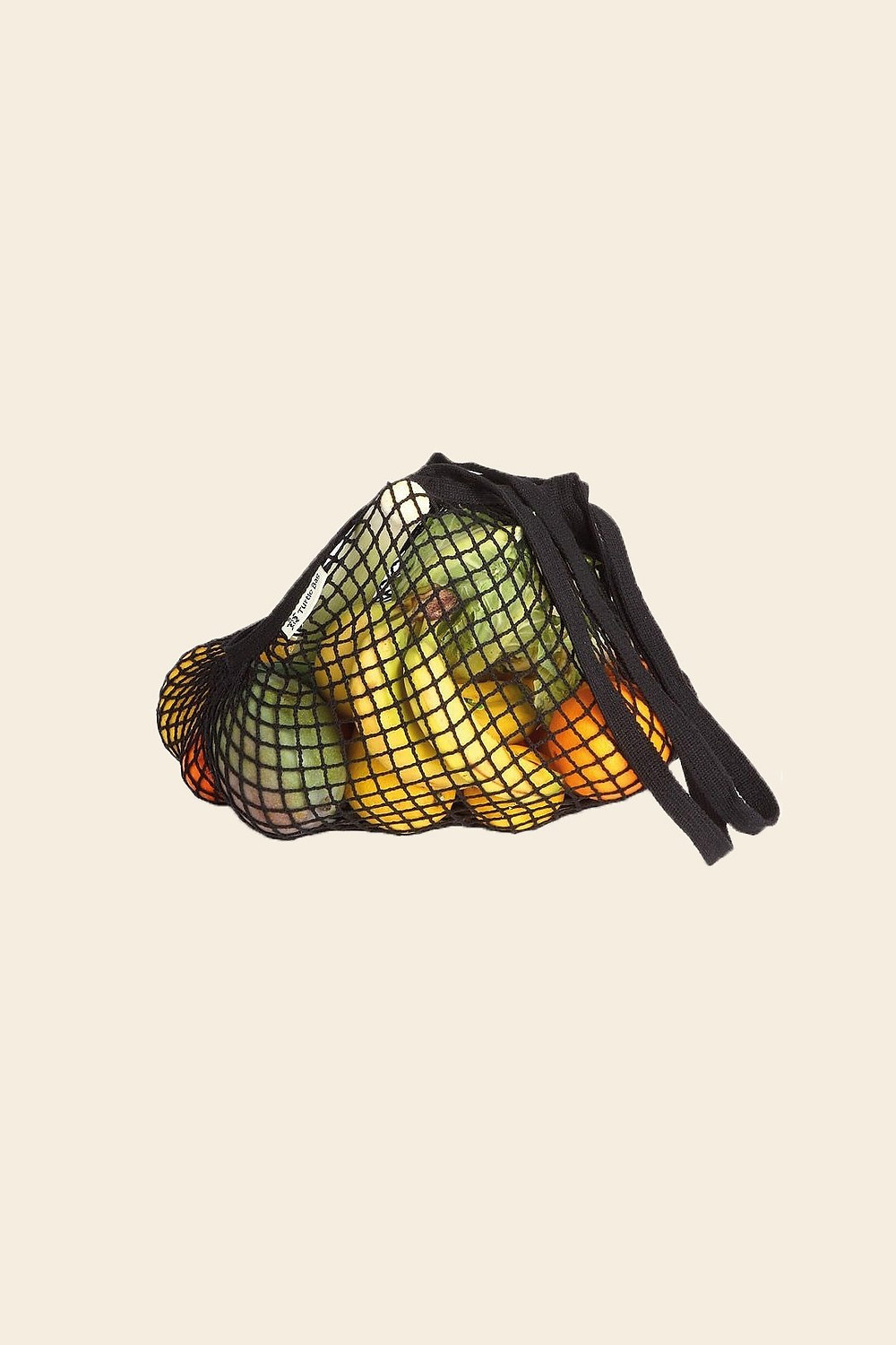 A fishnet bag full of vegetables and fruit