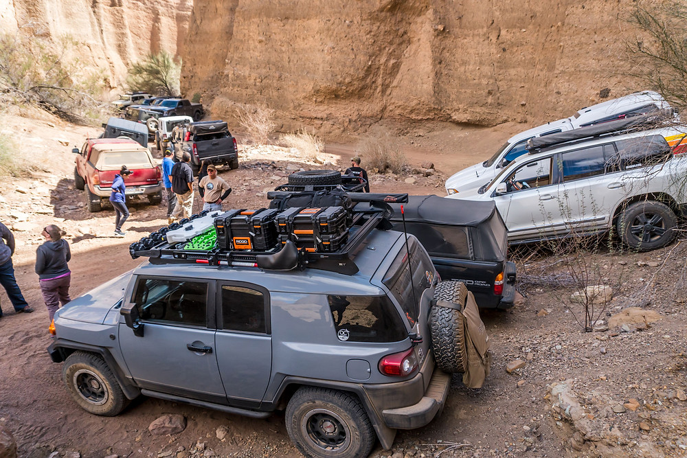 Collection of off-road vehicle in a canyon
