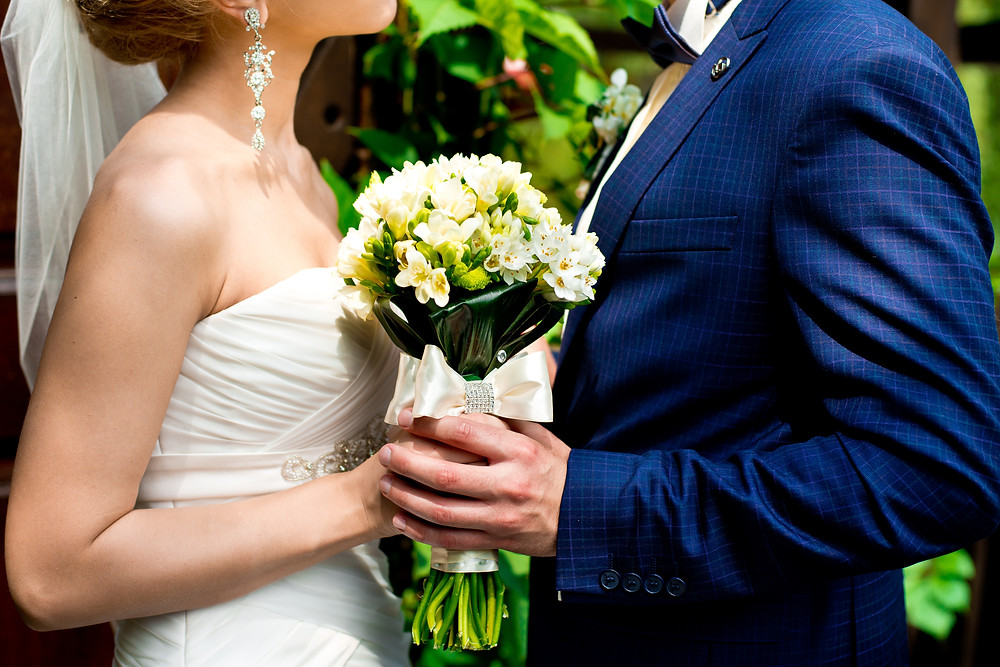Married couple holding bouquet