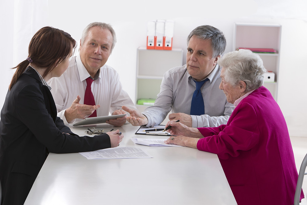 Family talking to solicitors