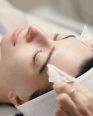 female-cosmetologist-making-facial-treat