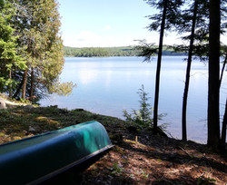 Canoe on shoreline of Trout Lake