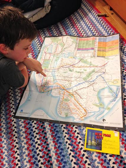 Boy looking at map