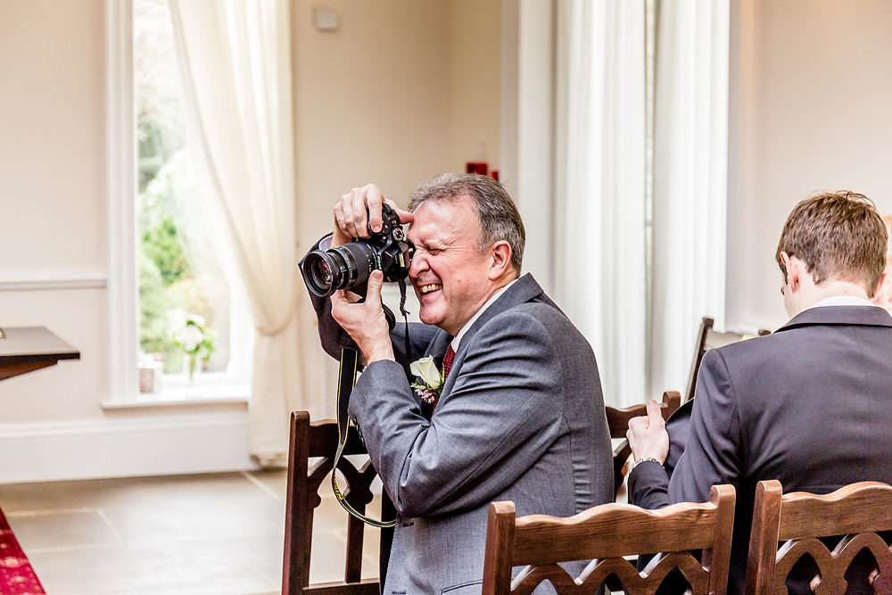 Wedding Photography portrait of a wedding guest taking photograph's