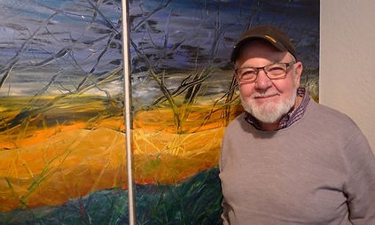 ARTIST WITH ABSTRACT LANDSCAPE