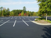 Parking Lot paved, striped and swept