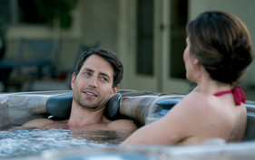 Couple talking in hot tub.jpg