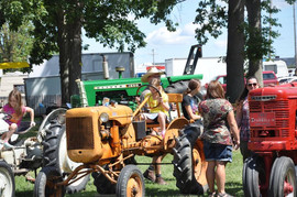 girl on antique tractor.jpeg