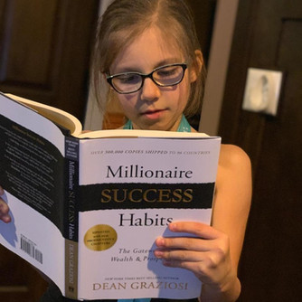 Abigail reading millionaire book.jpg