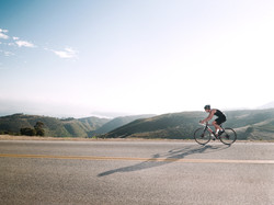 Man riding his bicycle on a steep hill