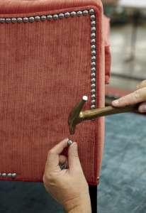 A custom nailhead trim is applied to a chair. Ethan Allen via AP