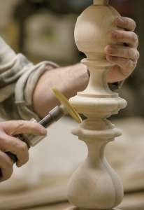 A craftsman sands a bed post. Ethan Allen via AP