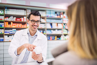 male-pharmacist-serving-a-female-custome