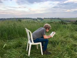 Sammy reading in fields