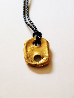 Gold plaited domino pendant