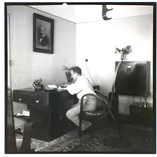 Bundi at home in Tel Aviv, surrounded by furniture & furniture he designed in Komarno, 1941-42