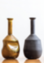 Glazed or mat earthenwar ceramic tall neck vases by laurie wiidvan heerden and ceramic matters available in spain france and portugal through mimic 2020 collection of african designs