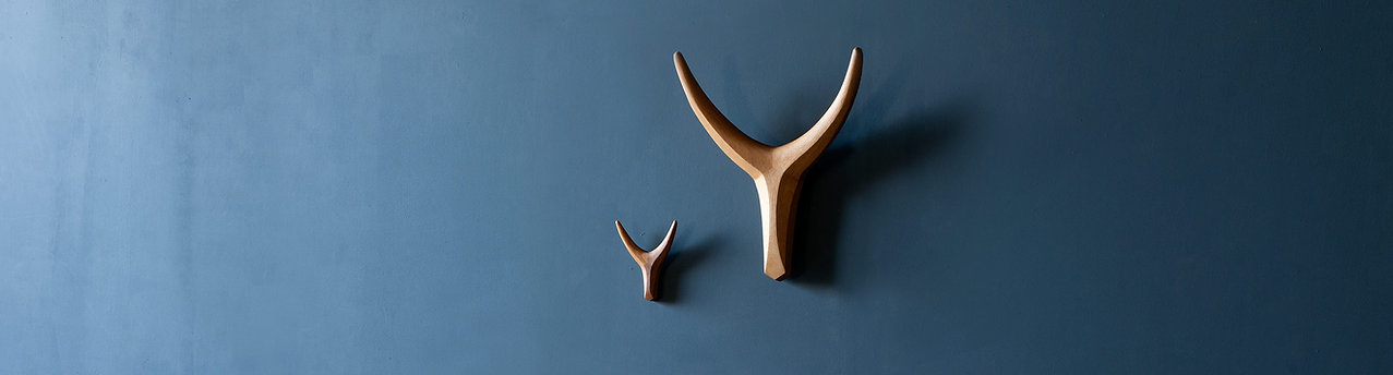 Large and small Wall mounted Nguni Heads crafted from african iroko by Vogel