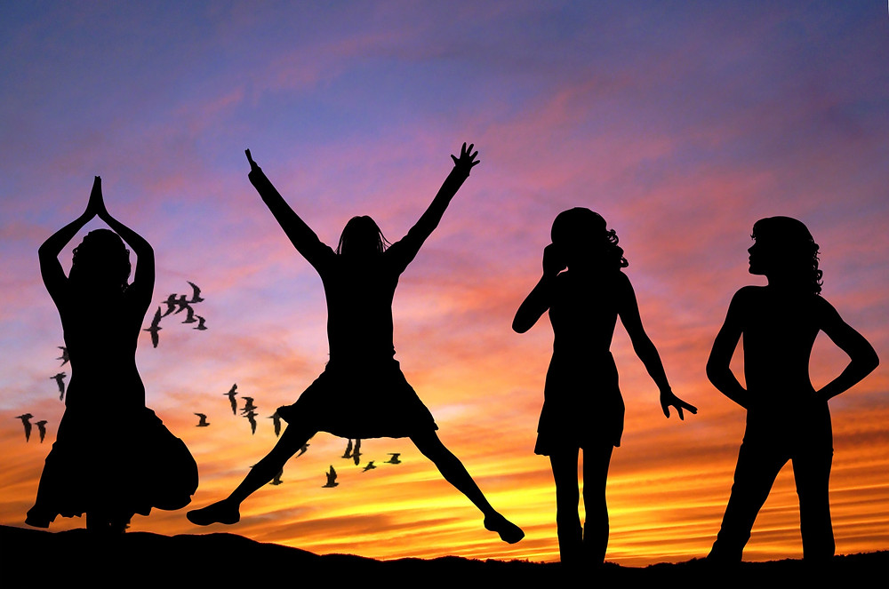Energy, jumping, girls having fun, silhouette in the sunset, sunrise, freedom, inspiration