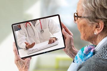 Senior woman consults a e-health doctor