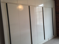 High gloss wardrobes in loft space