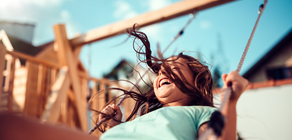 portrait-happy-little-girl-sitting-swing