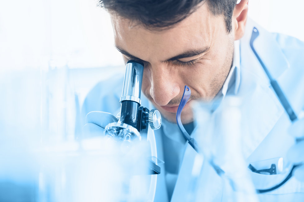 young-scientist-look-through-microscope-