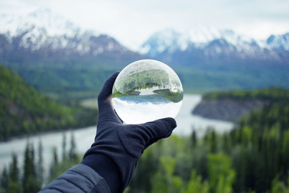Mountains in a glass sphere