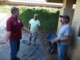 Allen Williams giving directions to Robert Hernandez and Lorenzo Garcia.