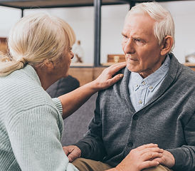 Elderly man with memory care specialist