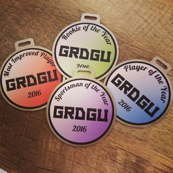 A few trophy tags for Grand Rapids Disc Golfers United