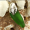 Thumbnail: Seaglass (rim of bottle top) with Handcrafted Monstera Palm Leaf