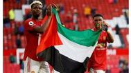 مدرب مانشستر يونايتد يدافع عن رفع لاعبين العلم الفلسطيني