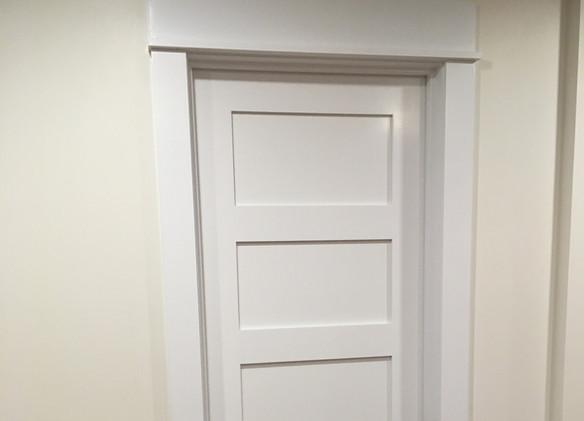 Craftsman style trim on 5 panel shaker door.