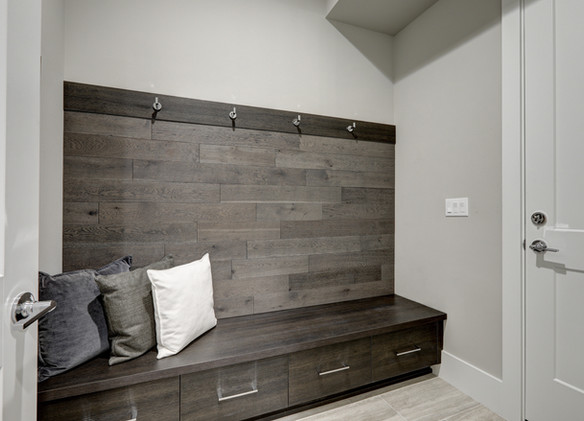 Gray Foyer features Half wood plank acce