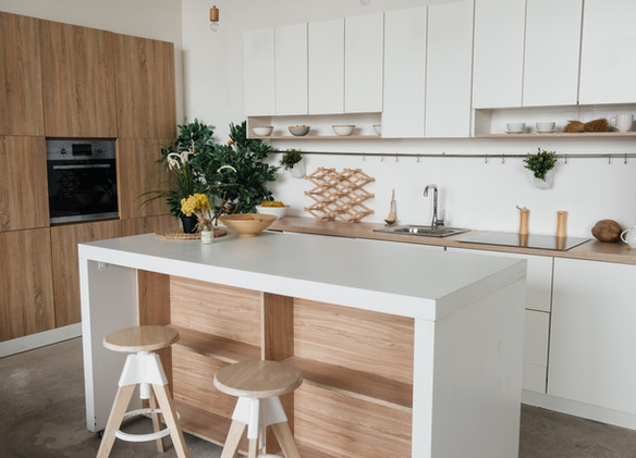 Stylish kitchen in white and brown wood.