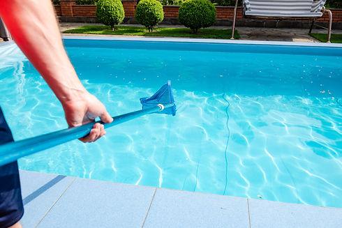 male-hand-holds-pool-net-cleaner.jpg
