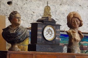 Antique busts and clock