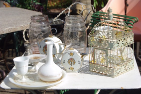 Antique vases, glass and a birdcage