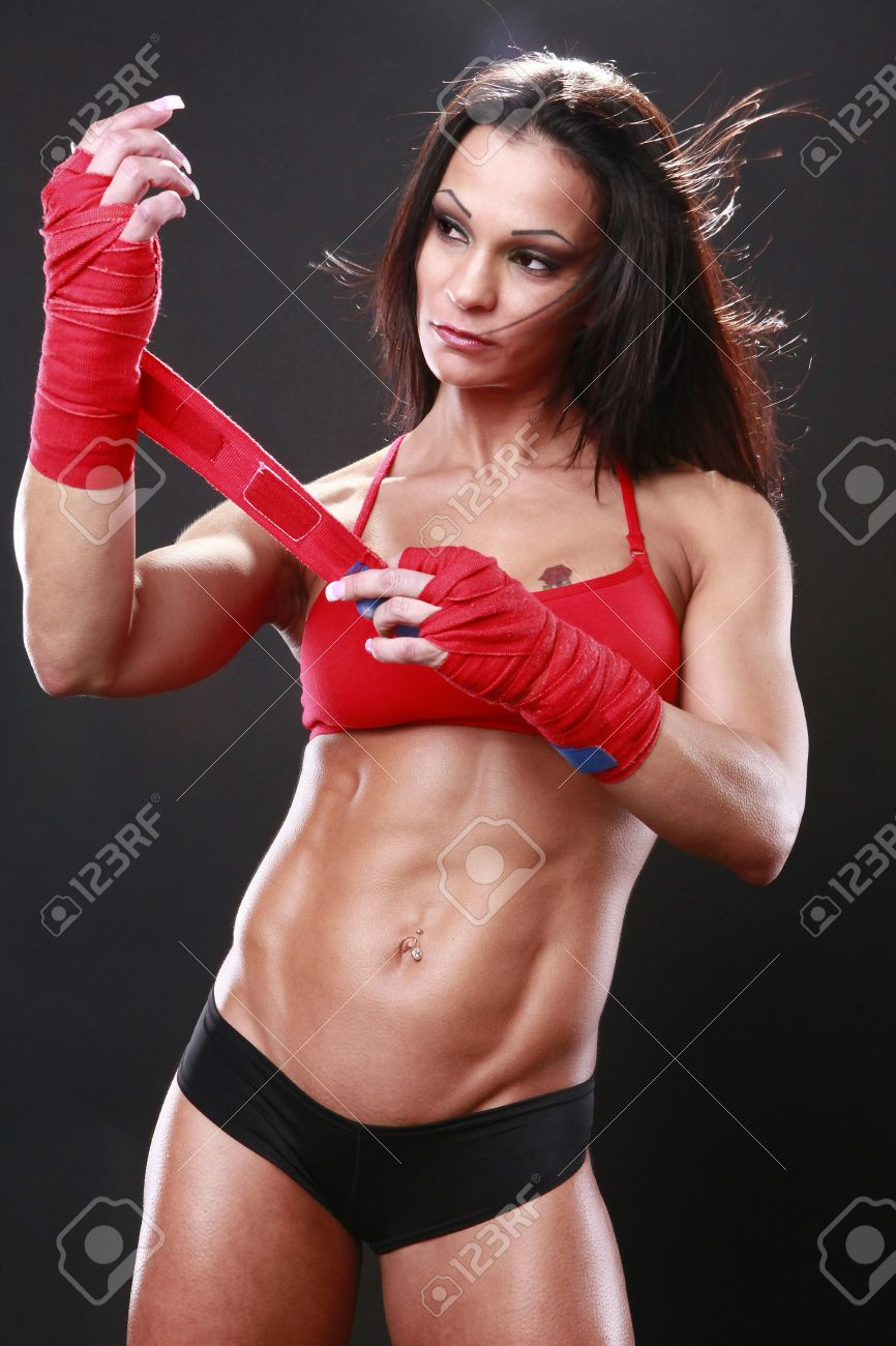 8706327-Body-builder-with-boxing-wraps-Stock-Photo-boxing-woman-female