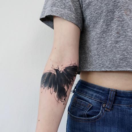 Brushstroke Bird Tattoo