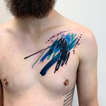 Watercolor Brushstroke Tattoo