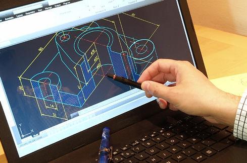 designer-working-on-a-cad-blueprint-1.jp