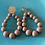Thumbnail: Boucles d'oreilles 𝑁𝑜𝑖𝑟-𝐵𝑙𝑎𝑛𝑐-𝑏𝑙𝑒𝑢-𝑁𝑢𝑑𝑒