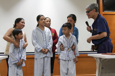 Dr. Duy, a vascular surgeon is awarding heart surgeries to these children with congenital heart disease (before their procedure). This is at the University Hospital in Ho Chi Minh City