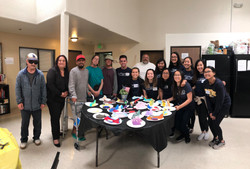 Painting wooden toys with patients at the IF Recuperative Center.