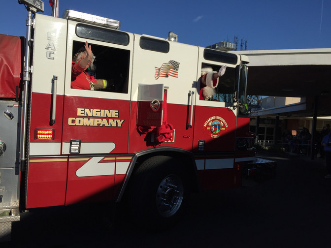 Celebrating the Holidays with Santa, Mrs. Clause, Firefighters and the Ralph Richardson Center kids-