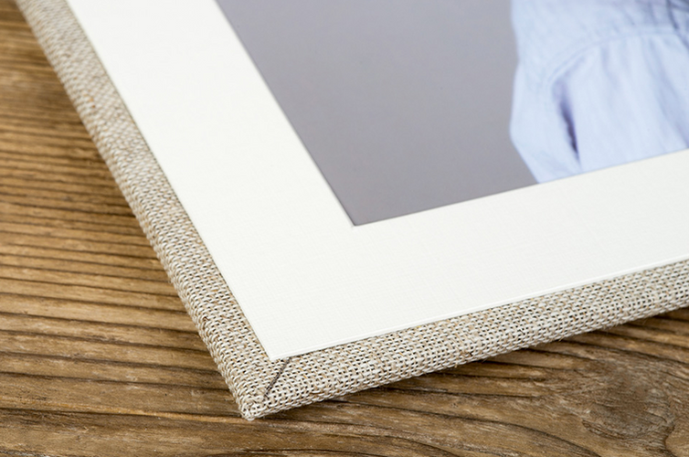 A natural linen cover finishes off the display, available in a range of colours.