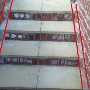 Paving not flush with garden walls (mortar filled)